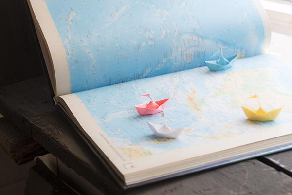 Travel-book-with-paper-boats