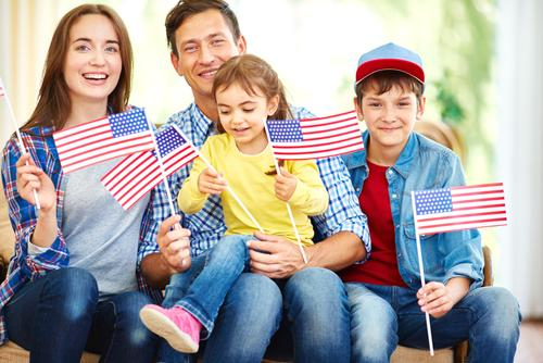 Family-holding-american-flags
