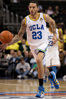 UCLA bruins player dribbling ball
