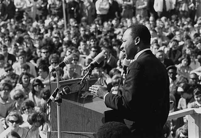 Martin Luther King addressing large crowd