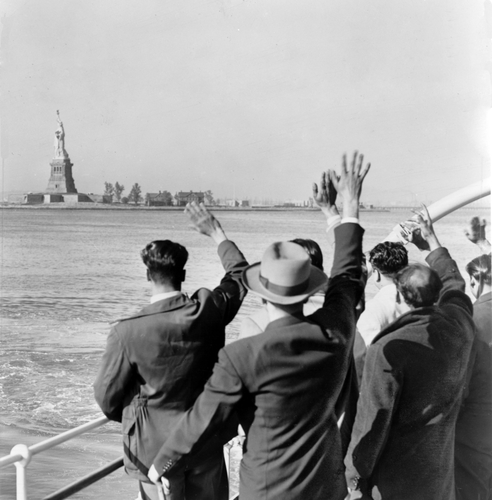 illegal immigrants wave statue of liberty