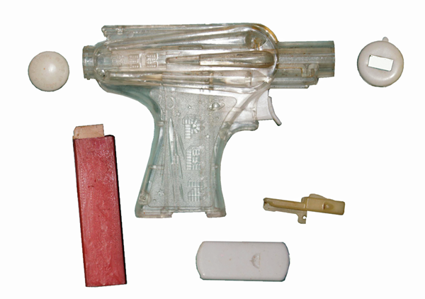 A disassembled clear 1950s PEZ space gun believed to be one of two examples known to exist. Reprinted from PEZ: From Austrian Invention to American Icon by Shawn Peterson (pg. 155, The History Press, 2016).
